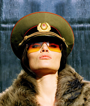 Young woman wearing Russian soldier's hat & fur coat, portrait